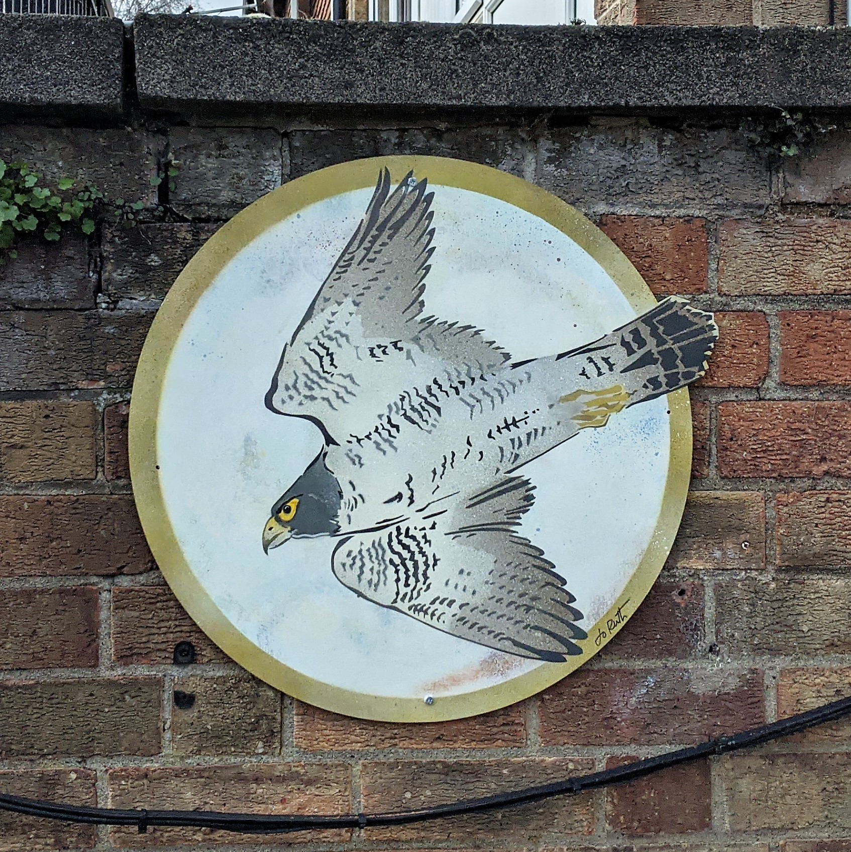 The Falcon disc mounted on a brick wall.