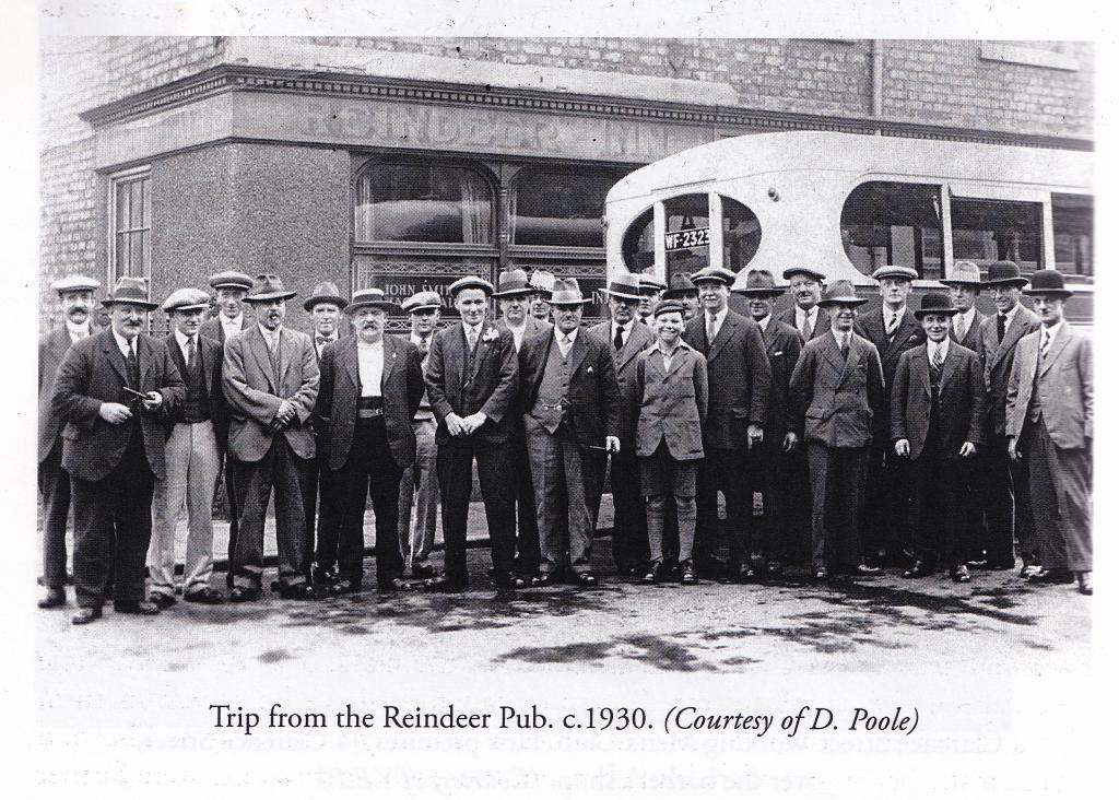 Image of group of men standing outside the Reindeer Inn in 1930s.